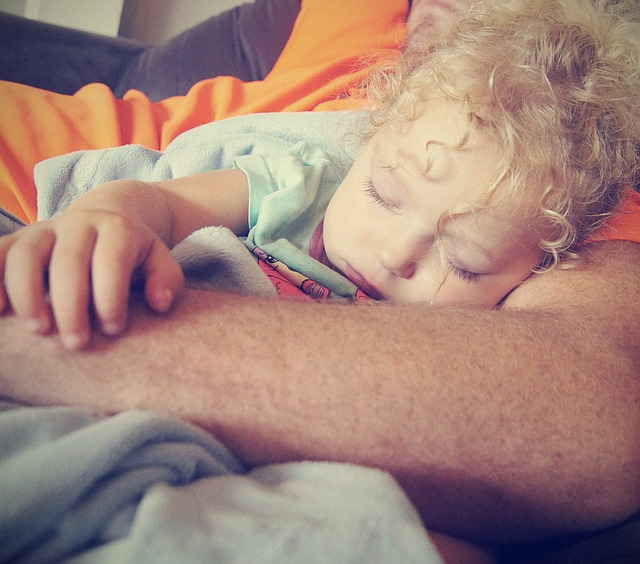 Child Asleep in Parent's Arms